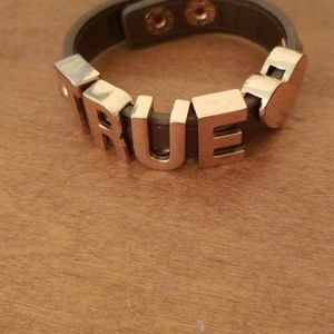 Jewelry - Brown bracelet with gold writing